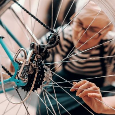 a woman fixes a bike